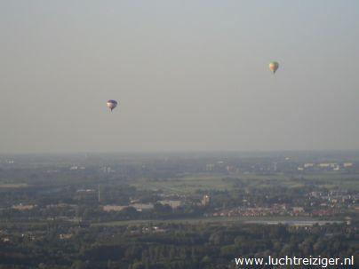 Geweldig uitzicht vanuit de luchtballon over het Rijnmondgebied.