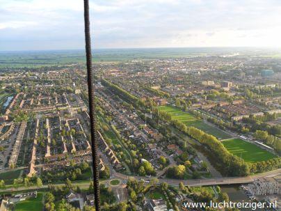 Uitzicht over Gouda vanuit luchtballon van Waddinxveen naar Cabauw